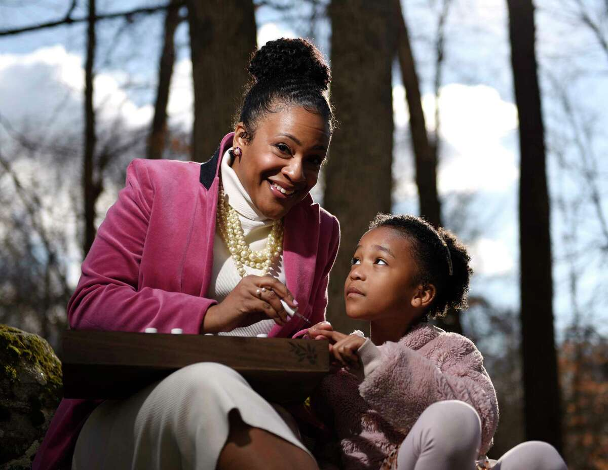 Khandice O'Kelley and her daughter, Taylor O'Kelley, 7, put on Pink Chawkulit nail polish at their home in Stamford, Conn. Wednesday, Jan. 20, 2021. Khandice and Taylor's routine of going to the nail salon was disrupted because of COVID-19, so the two decided to start making their own nail polish. The startup, which they've branded as Pink Chawkulit, features toxin-free polishes and has quickly gained quite a following.