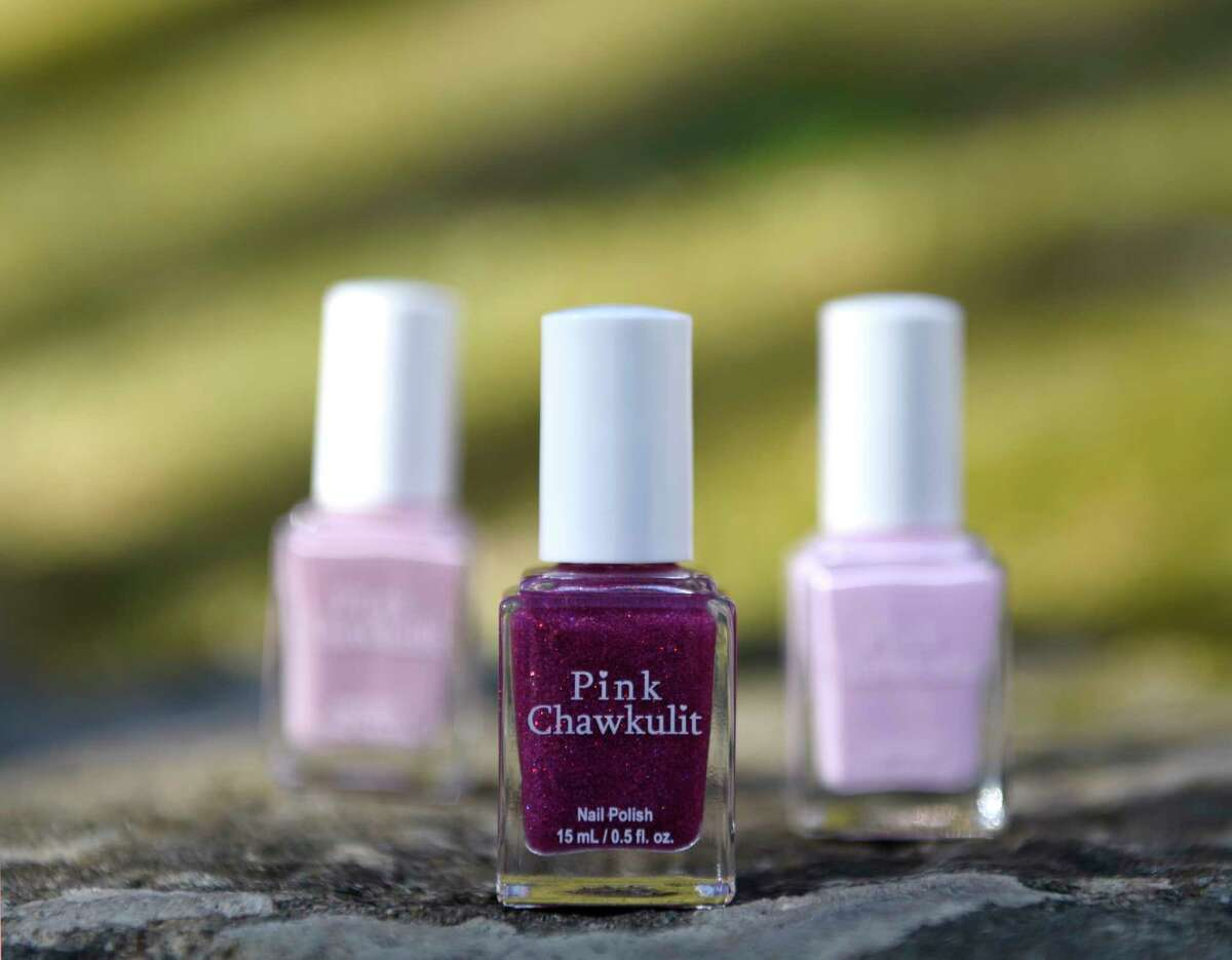 Pink Chawkulit nail polish is displayed at the O'Kelley home in Stamford, Conn. Wednesday, Jan. 20, 2021. Khandice O'Kelley and her seven-year-old daughter Taylor's routine of going to the nail salon was disrupted because of COVID-19, so the two decided to start making their own nail polish. The startup, which they've branded as Pink Chawkulit, features toxin-free polishes and has quickly gained quite a following.