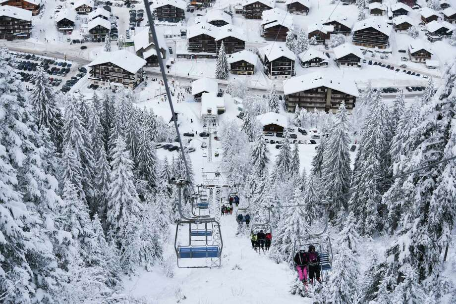Skiers ride the chairlift to the top of the mountain in Morgins, Switzerland, on Jan. 16, 2021. Photo: Photo For The Washington Post By Caroline Fernandez/Hans Lucas / The Washington Post
