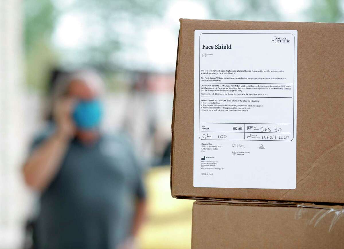 Volunteers helped distribute 3,000 facemasks for health professionals at the Habitat for Humanity ReStore, Wednesday, April 22, 2020, in Conroe.