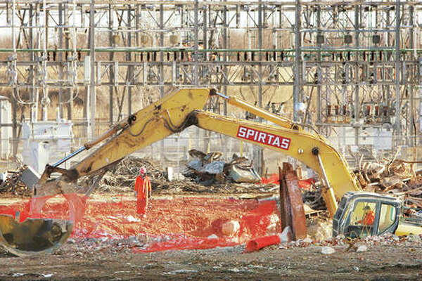 Workers from Spitas Wrecking in St. Louis moved right in at the old Wood River Power Station in East Alton Thursday to start removing concrete debris following two controlled explosions at the site. The blasting was used on the back side of former power plant, away from Illinois 143, to break apart large reinforced concrete pours at the 1950's era, 465-megawatt, coal-fueled power plant last operated by Dynegy Midwest Generation Inc. The plant closed in May of 2016 and, at that time, employed only 90 people.