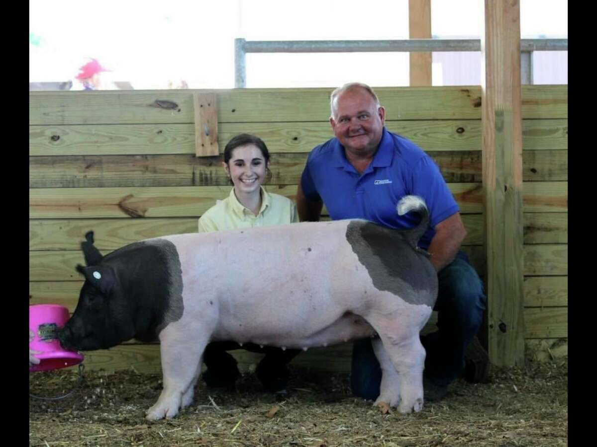 Grand champion gilt and grand champion showperson Dalaney Bates during the 2020 livestock show. (Huron Community Fair/Courtesy Photo)