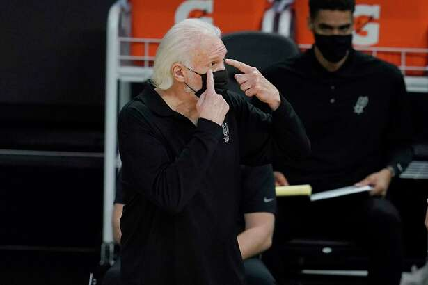San Antonio Spurs head coach Gregg Popovich gestures during the second half of his team's NBA basketball game against the Golden State Warriors in San Francisco, Wednesday, Jan. 20, 2021. (AP Photo/Jeff Chiu)