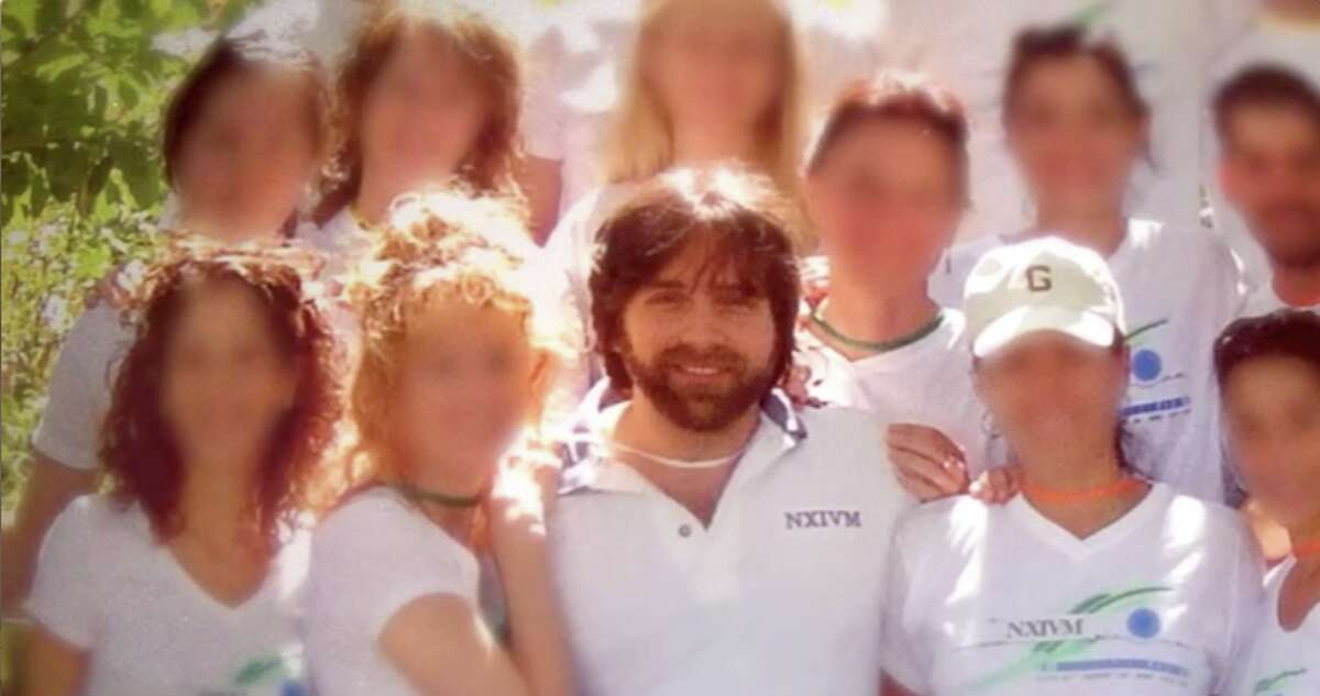 """NXIVM leader Keith Raniere, seen here with many women, will be the focus of the next episode of the CNBC documentary true crime series """"American Greed"""" on Monday night, Jan. 25 when it premieres at 10 p.m"""