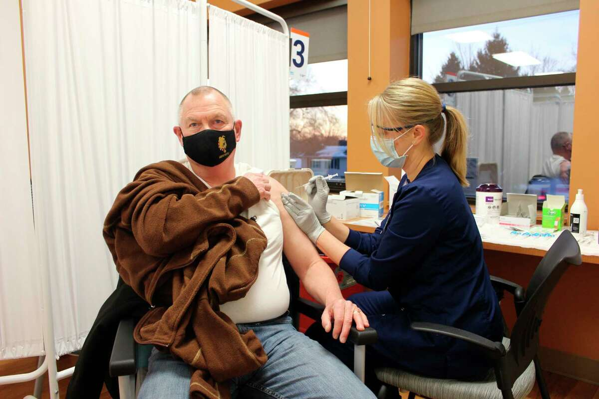 Terry Nerbonne receives his COVID-19 vaccine from Registered Nurse Julie Hatchew. Nerbonne was first in line to receive the vaccine Thursday. (Courtesy photo)