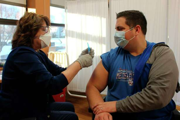 Kyle Talicska receives his first dose of the COVID-19 vaccine. As the principal of Mecosta Elementary School, he was placed in the 1B priority group, which includes educators as well as other frontline workers. (Courtesy photo)