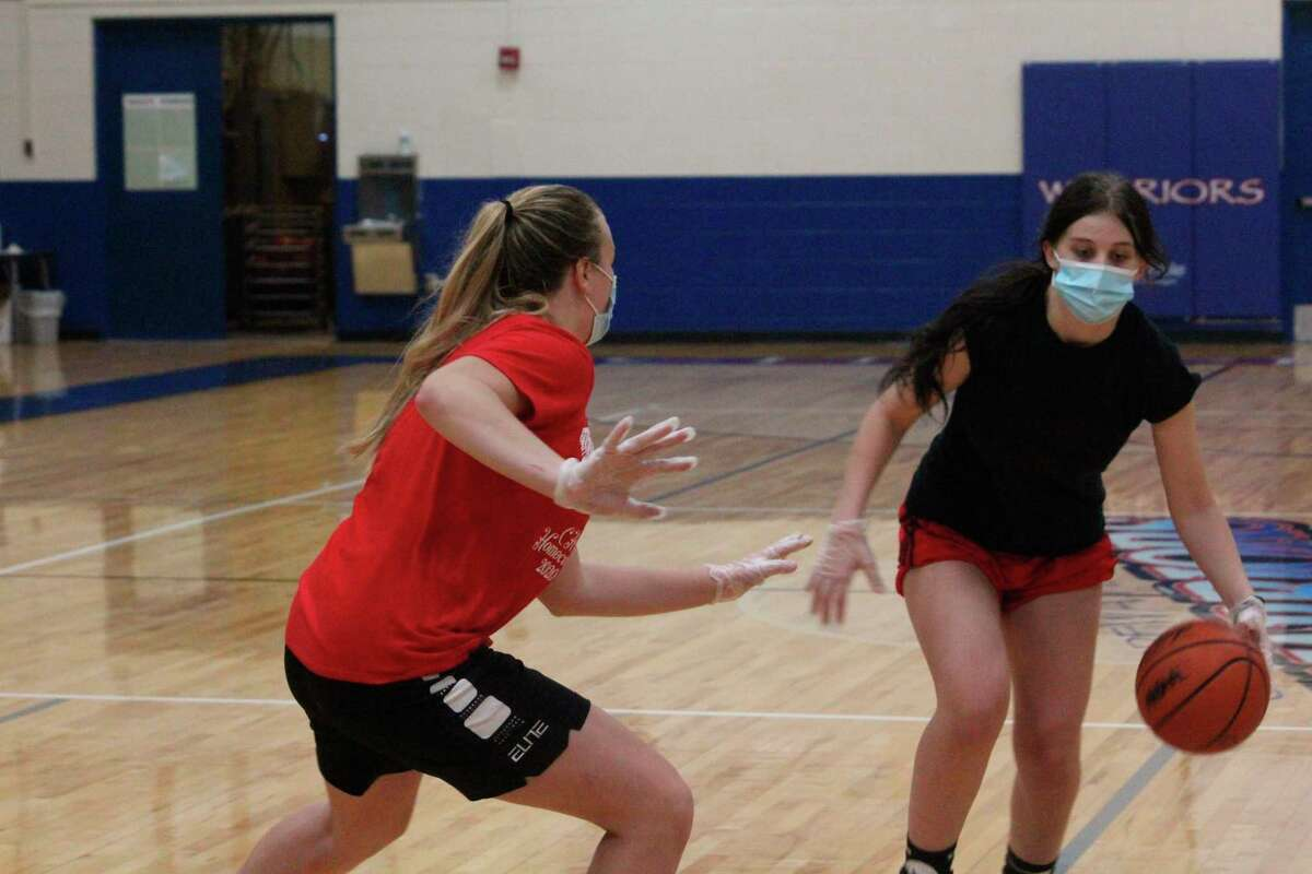 Chippewa Hills' Desiree Brown (right) works one-on-one against teammate Madison Wrisley during a practice on Nov. 9. Practices were suspended on Nov. 16 by the state health department because of rising COVID numbers and reinstated on Jan. 16 under a noncontact basis. (Pioneer photo file photo)