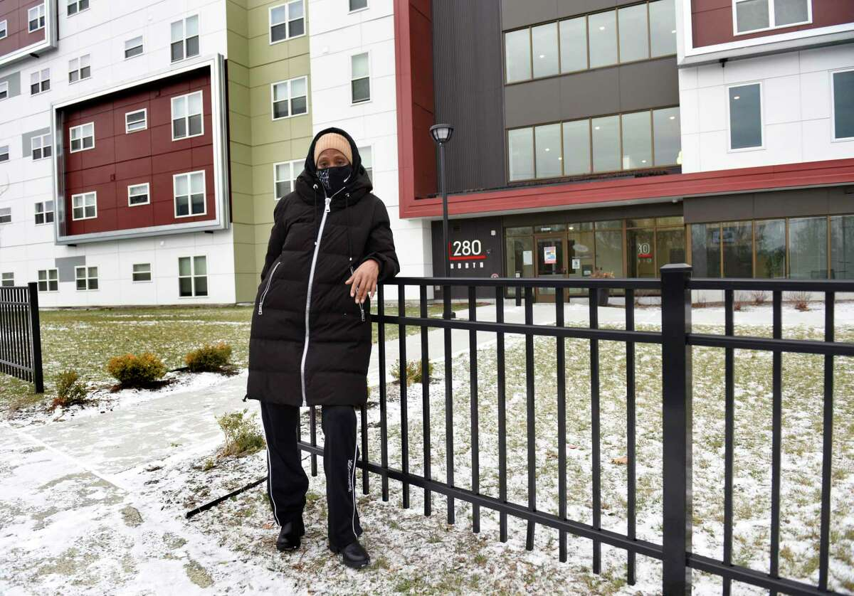 SNAP recipient Moneique Ballou stands outside her apartment building in Arbor Hill on Thursday, Jan. 21, 2021 in Albany, N.Y. (Lori Van Buren/Times Union)