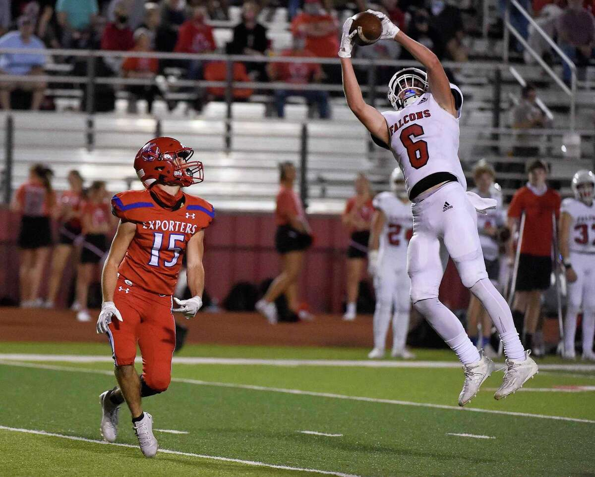Huffman defensive back Tyler Wilkins (6) intercepts a pass intended for Brazosport wide receiver Pablo Marin (15) during the second half of a 4A Division I Region III high school football playoff game, Friday, Nov. 20, 2020, in Splendora, TX.