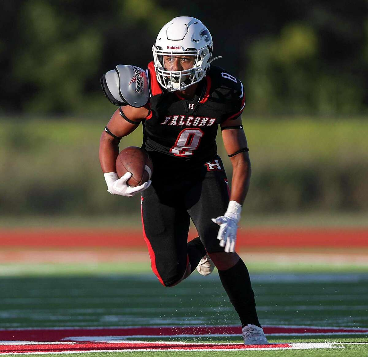 Huffman Falcons Dallas McNeal (8) rushes during the first half of a football game Tuesday, Sept. 29 2020, at Huffman Falcon Stadium in Houston.