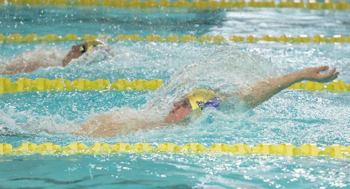 Midland High's Legend Jankowski leads teammate Garrett Hoppman in the backstroke portion as they compete in the boys 200 yard IM 01/21/2021 at COM Aquatics. Tim Fischer/Reporter-Telegram