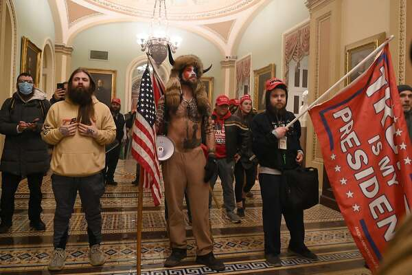 AFP presents a retrospective photo package of 60 pictures marking the 4-year presidency of President Trump. Supporters of US President Donald Trump, including member of the QAnon conspiracy group Jake Angeli, aka Yellowstone Wolf (C), enter the US Capitol on January 6, 2021, in Washington, DC. - Demonstrators breeched security and entered the Capitol as Congress debated the a 2020 presidential election Electoral Vote Certification. (Photo by Saul LOEB / AFP) (Photo by SAUL LOEB/AFP via Getty Images)