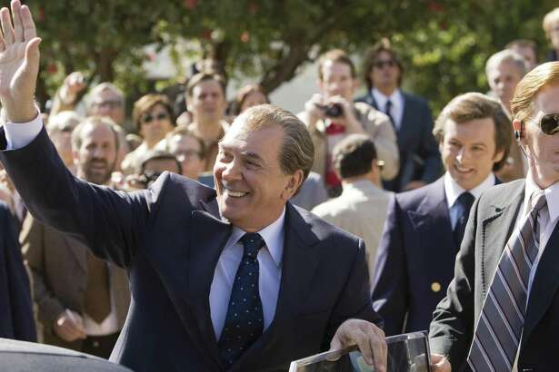 "(L to R) Richard Nixon (played by Frank Langella) greets an audience while David Frost (played by Michael Sheen) looks on in a drama that tells of the electrifying battle between a disgraced president with a legacy to save and a jet-setting television personality with a name to make in ""Frost/Nixon,"" from director Ron Howard."