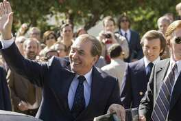 """(L to R) Richard Nixon (played by Frank Langella) greets an audience while David Frost (played by Michael Sheen) looks on in a drama that tells of the electrifying battle between a disgraced president with a legacy to save and a jet-setting television personality with a name to make in """"Frost/Nixon,"""" from director Ron Howard."""