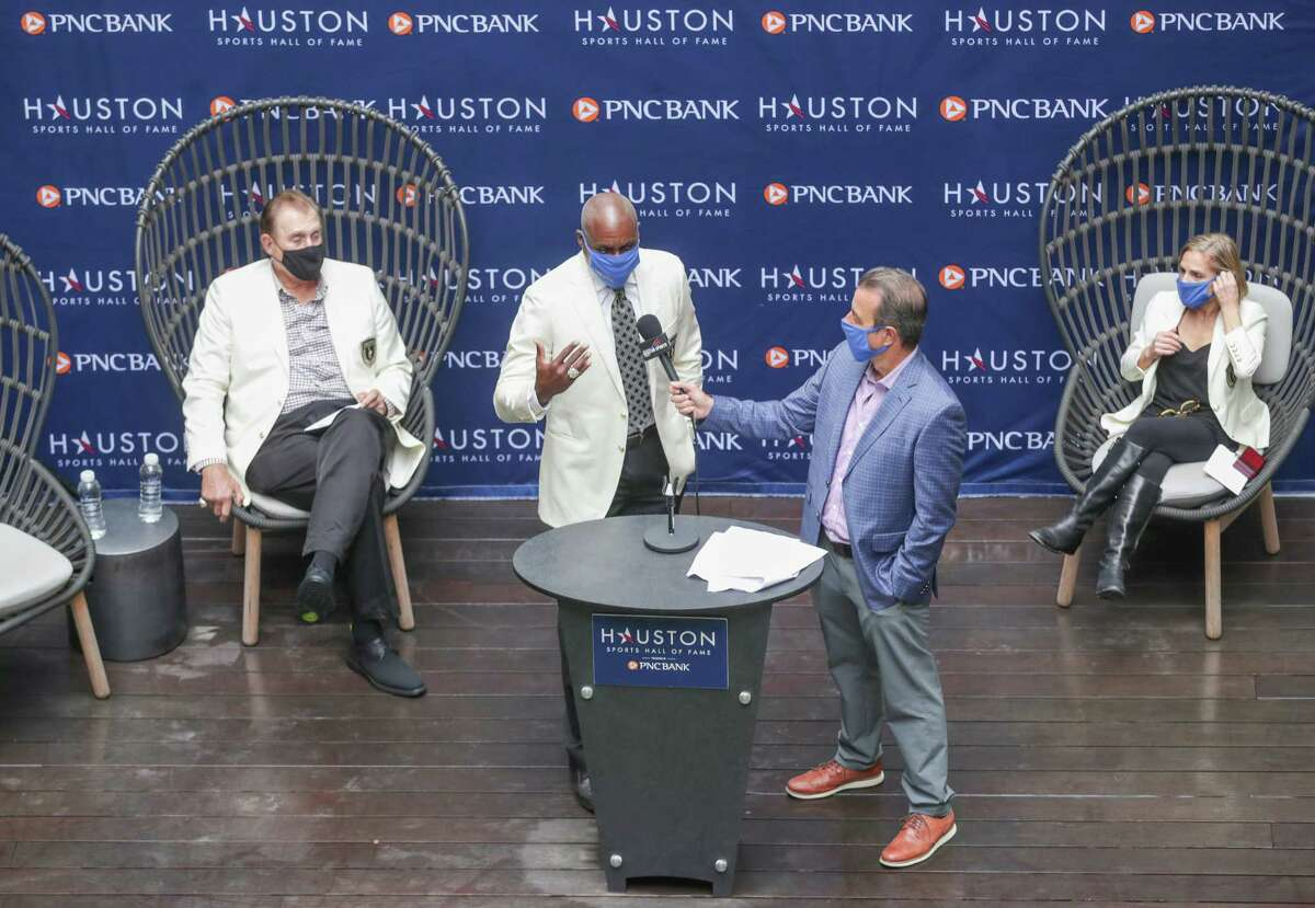 Carl Lewis talks during the Houston Sports Hall of Fame Ring Presentation and Walk of Fame Unveiling Thursday, Jan. 21, 2021, in Houston. Lewis, Mary Lou Retton, Rudy Tomjanovich and the late Bob Lanier were honored at the event
