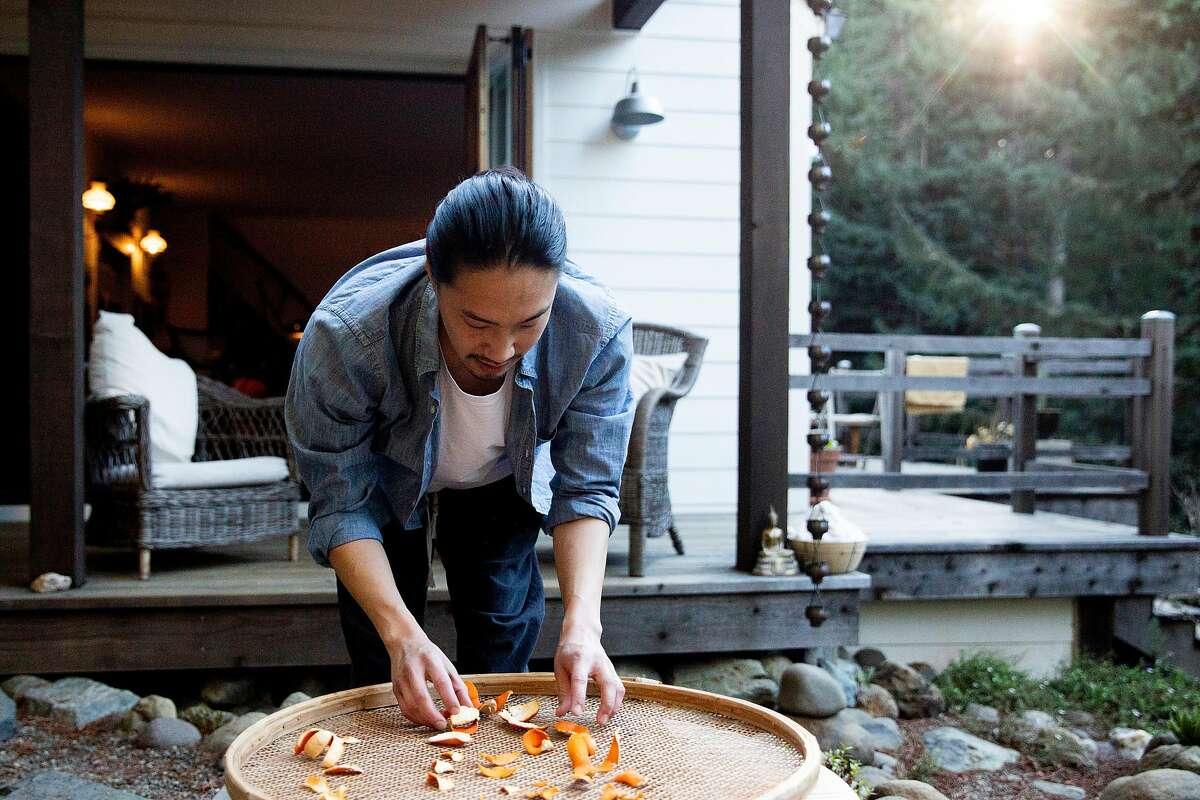 Adrian Chang organizes citrus peels.