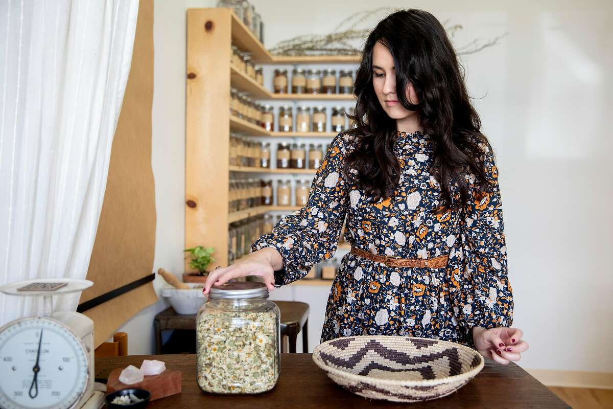 Erin Wilkins organizes herbs inside of her shop Herb Folk in Petaluma, Calif.