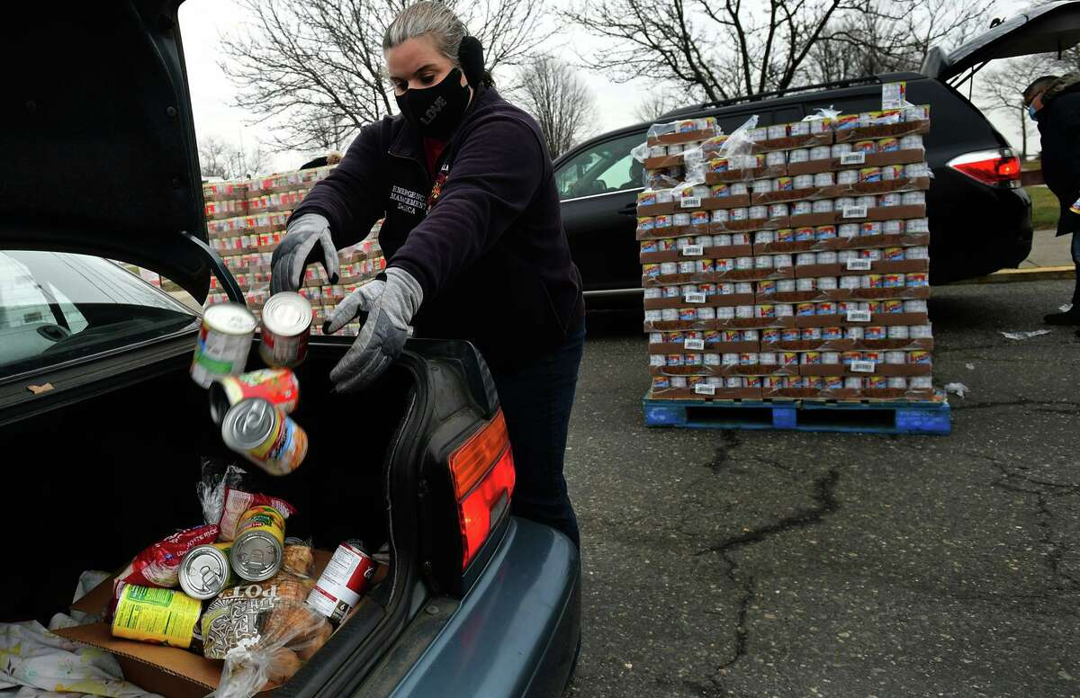Food donations are distributed in mid-January 2021 in Norwalk, Conn. The state received more than 11,000 new claims for unemployment assistance that week, with President Biden proposing a $1.9 trillion stimulus package in taking office.