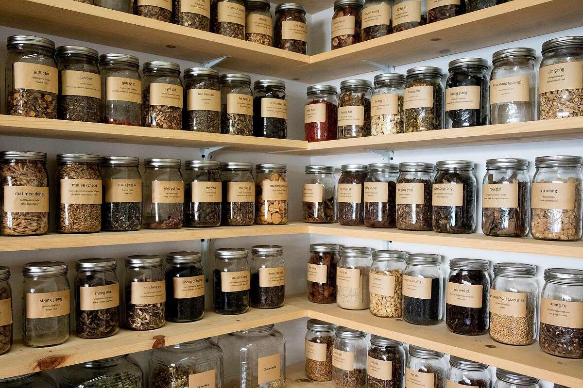 Jars of Chinese herbs line the walls of Erin Wilkins' shop Herb Folk in Petaluma, Calif.