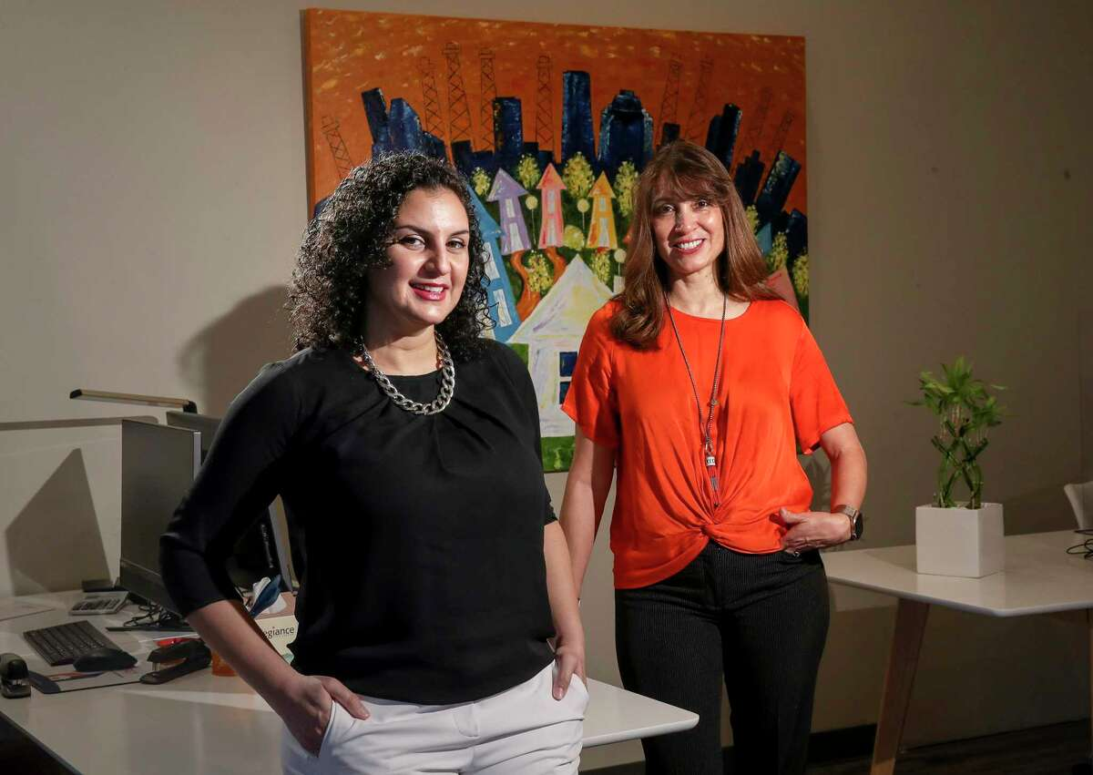 Azalia Benjamin-Mathis, left, a former educator turned realtor, credits her boss and mentor Sherry Campbell, founder of Energy Realty, with helping her career.