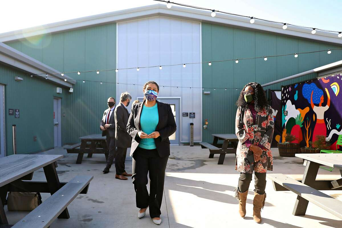 Mayor London Breed (left), with Pamela Gilmore, director of the residential and homeless division at Bayview Hunters Point Foundation, tours the Bayview SAFE Navigation Center on Thursday.