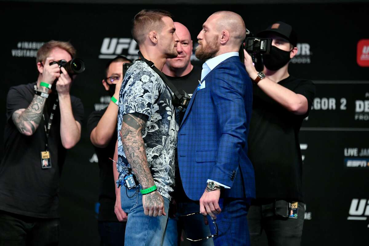 ABU DHABI, UNITED ARAB EMIRATES - JANUARY 21: In this handout image provided by the UFC, (L-R) Opponents Dustin Poirier and Conor McGregor pose face off for media during the UFC 257 press conference event inside Etihad Arena on UFC Fight Island on January 21, 2021 in Yas Island, Abu Dhabi, United Arab Emirates. (Photo by Jeff Bottari/Zuffa LLC via Getty Images)