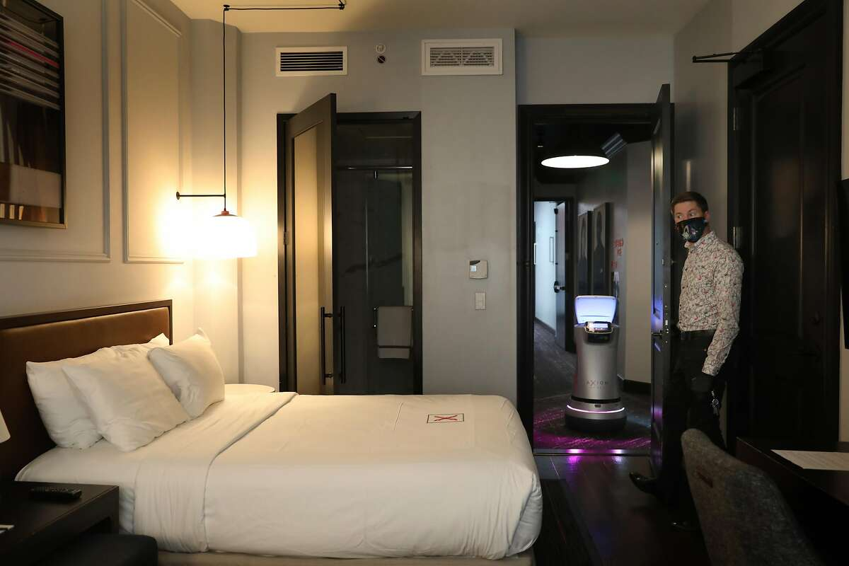 Manager Jeremy Kueffner shows a room at the Hotel Axiom and Astro in San Francisco.