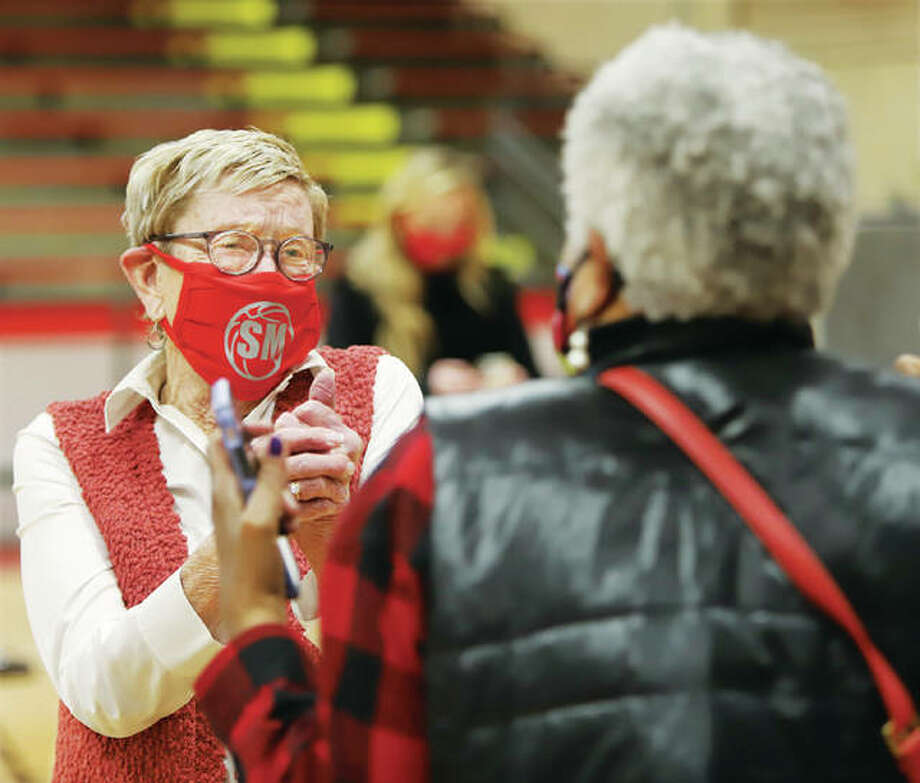 Millicent McAfoos, widow of Stan McAfoos, was emotional Thursday as she greeted old friends at the dedication ceremony to re-name the gym at West Elementary in memory of her late husband, the legendary basketball coach who is the winningest coach in AHS history. Photo: John Badman | The Telegraph