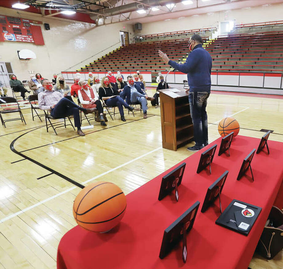 Pastor David Goins, from the Morning Star Missionary Baptist Church in Alton, a retired Alton Police officer, and one of the many Alton High School students to play basketball for Stan McAfoos, addresses the McAfoos family and others Thursday at the Thursday ceremony to re-name the gym at West Elementary in honor of the longtime basketball coach. Photo: John Badman   The Telegraph