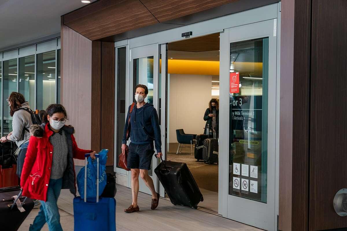 A traveler exits San Francisco International Airport.
