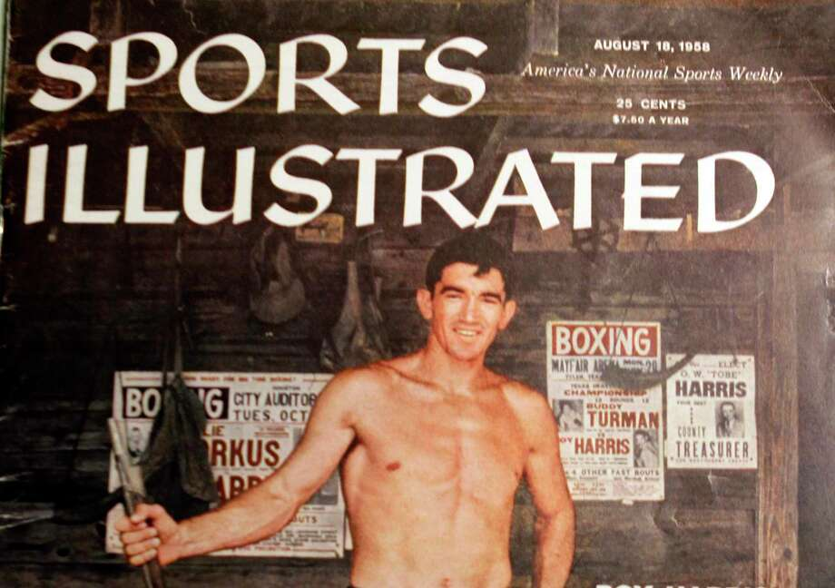 A copy of Sports Illustrated August 18, 1958 magazine cover is shown featuring boxer Roy Harris of Cut and Shoot. Roy Harris, who in addition to being a boxing legend, served as Montgomery County clerk for 28 years. Photo: Melissa Phillip, Staff / Houston Chronicle / © 2014  Houston Chronicle