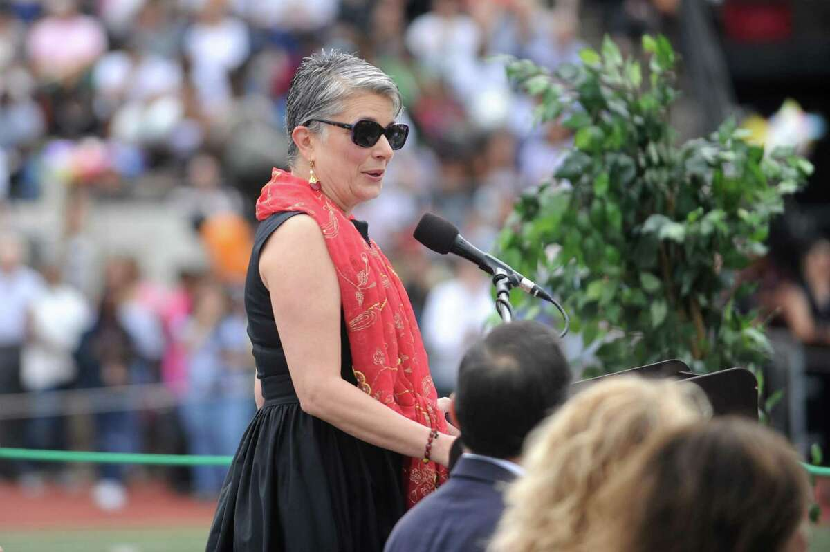 Fran Pastore, CEO of the Women's Business Development Council, gives the commencement address during the Stamford High School class of 2018 commencement ceremony in Stamford High School's Boyle Stadium on Friday, June 22, 2018.