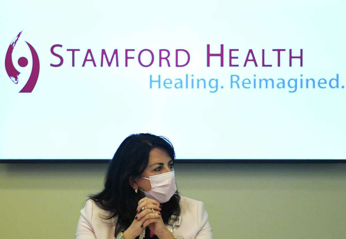 Stamford Health President and CEO Kathleen Silard speaks during the COVID-19 roundtable discussion with U.S. Sen. Chris Murphy, D-Conn., at Stamford Hospital in Stamford, Conn. Tuesday, Oct. 13, 2020. U.S. Sen. Murphy joined Stamford Health President and CEO Kathleen Silard, Chair of Infectious Diseases Dr. Michael Parry, and other clinical leaders to discuss the current state of coronavirus cases, future vaccines, testing, PPE, and more.