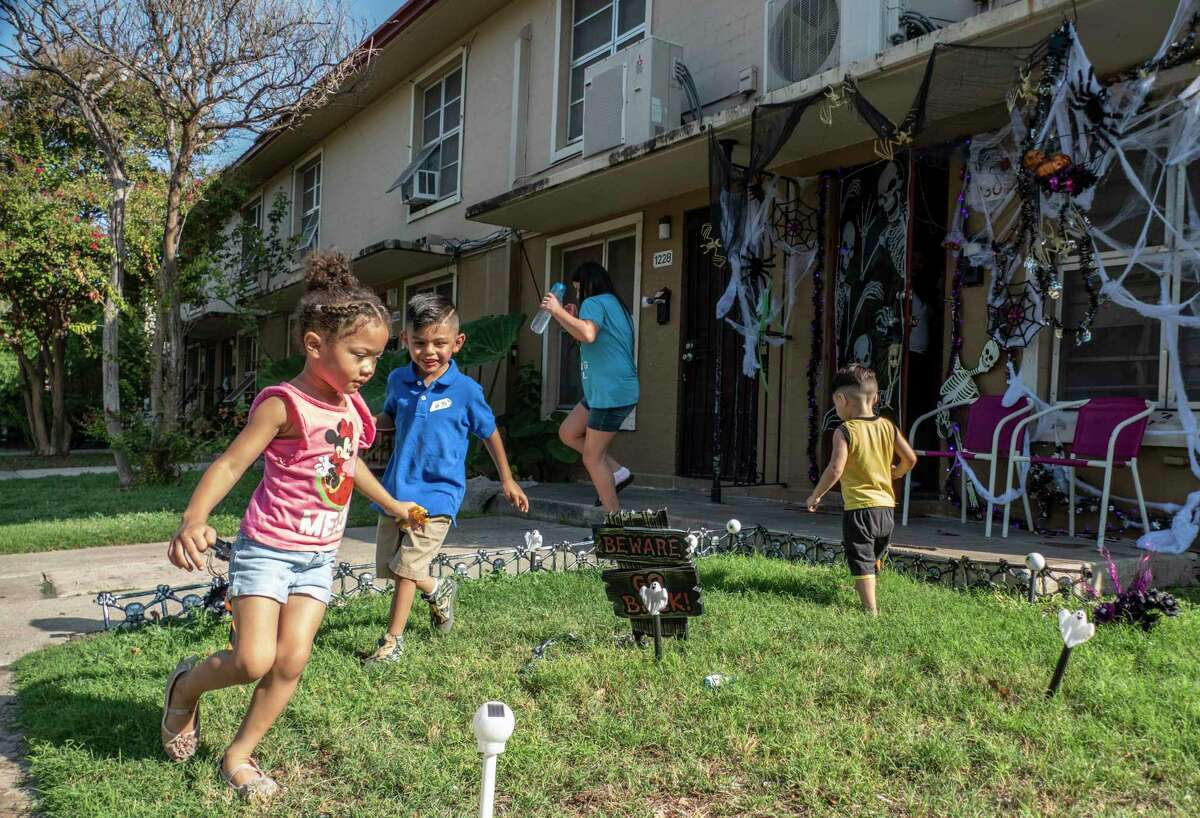 Children play at the Alazan Courts on Thursday, Sept. 24, 2020. Much of Alazan Courts, the first public housing complex in San Antonio, was built in 1939 and people, mostly Mexican-Americans, began to move in during 1940.