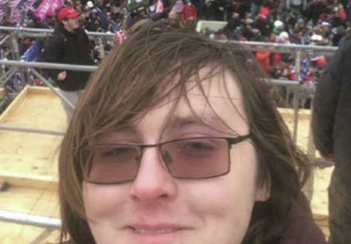 A selfie-style picture Patrick Edward McCaughey III allegedly took while standing on the scaffolding of the west front of the U.S. Capitol around 2:35 p.m. Jan. 6, 2021.