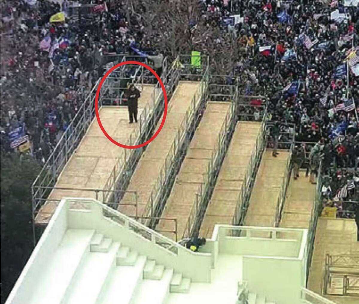 Surveillance footage shows someone consistent in the appearance with Patrick Edward McCaughey III standing atop the scaffolding outside the Capitol, Jan. 6, 2021, according to an affidavit.