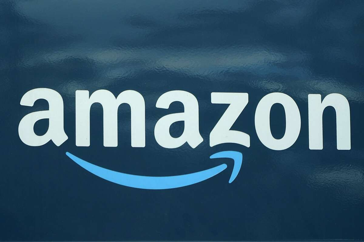 An Amazon logo appears on an Amazon delivery van, Thursday, Oct. 1, 2020.