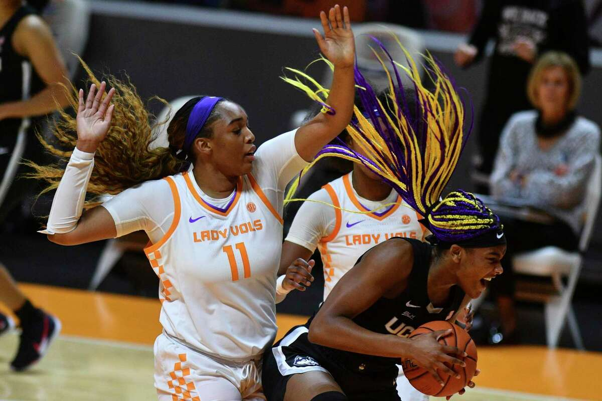 Connecticut's Aaliyah Edwards (3) attempts to keep a ball in bounds while defended by Tennessee's Kasiyahna Kushkituah (11) during an NCAA college basketball game in Knoxville, Tenn., Thursday, Jan. 21, 2021. (Saul Young/Knoxville News Sentinel via AP, Pool)