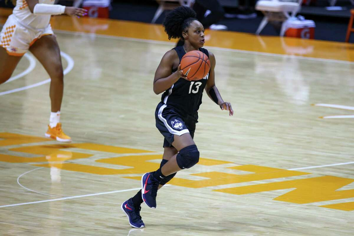 Jan 21, 2021; Knoxville, Tennessee, USA; UConn Huskies guard Christyn Williams (13) brings the ball up court against the Tennessee Lady Vols during the second half at Thompson-Boling Arena. Mandatory Credit: Randy Sartin-USA TODAY Sports