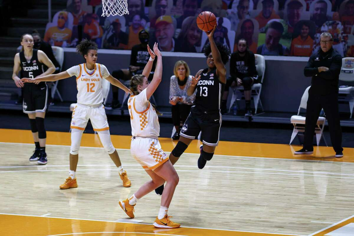 UConn Huskies guard Christyn Williams (13) shoots the ball against Tennessee Lady Vols guard Marta Suarez (33) during the second half at Thompson-Boling Arena.