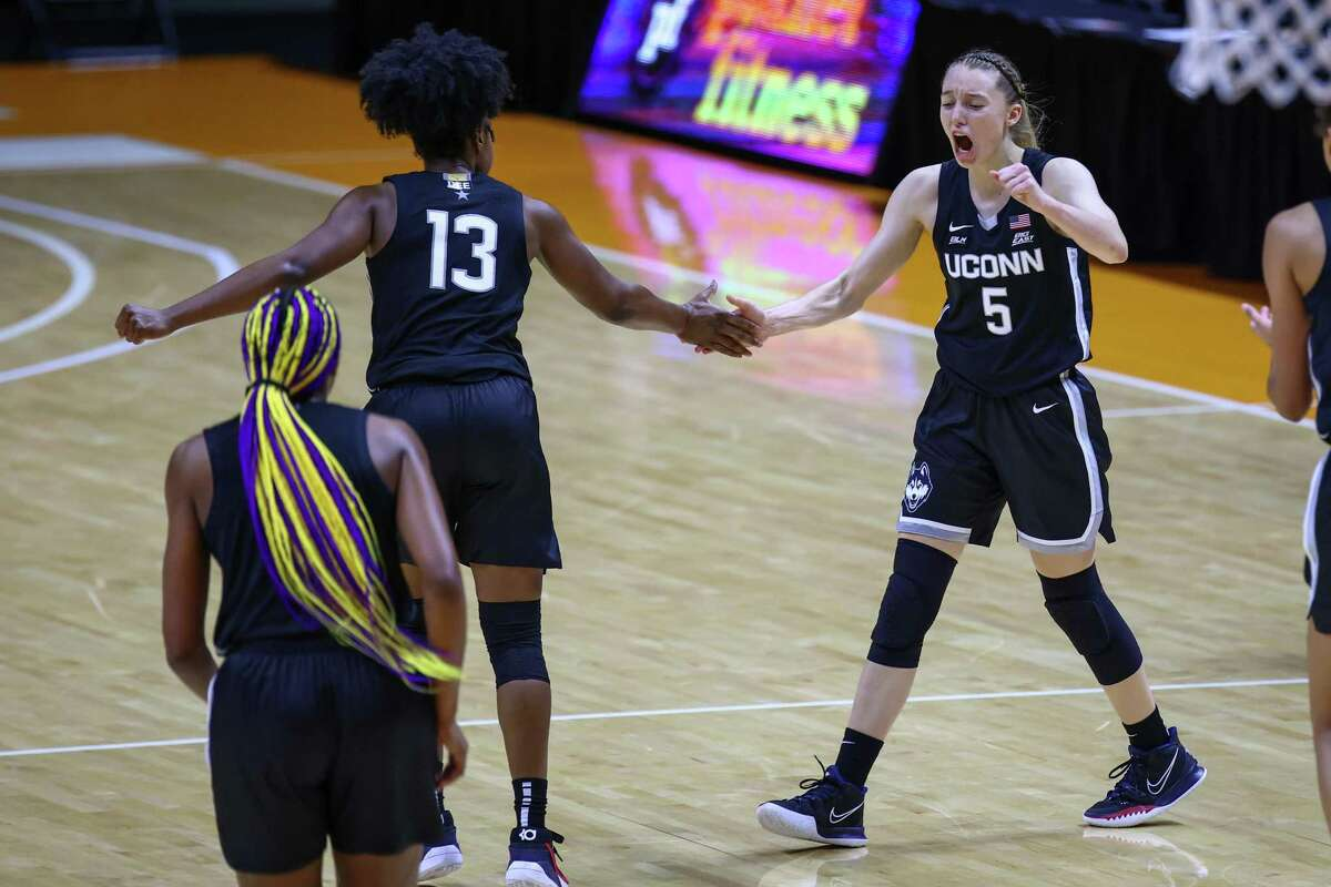 Jan 21, 2021; Knoxville, Tennessee, USA; UConn Huskies guard Christyn Williams (13) and guard Paige Bueckers (5) celebrate a play against the Tennessee Lady Vols during the second half at Thompson-Boling Arena. Mandatory Credit: Randy Sartin-USA TODAY Sports