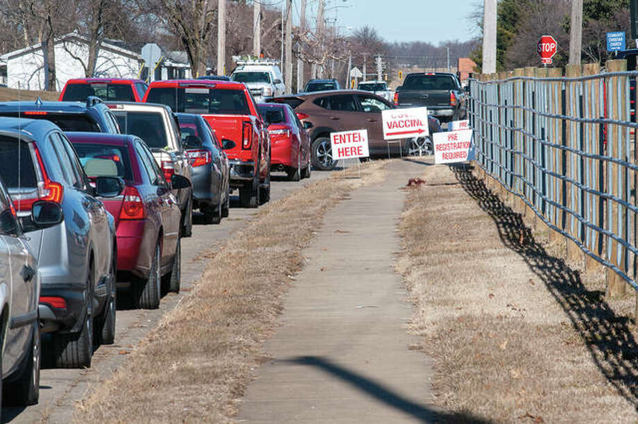 Cars wait Thursday to enter the Morgan County Fairgrounds for COVID-19 vaccinations. Pre-registration was required for the event, which was for those 75 and older. Health departments across Illinois are delivering the vaccinations in phases as supplies become available. Photo: Darren Iozia | Journal-Courier