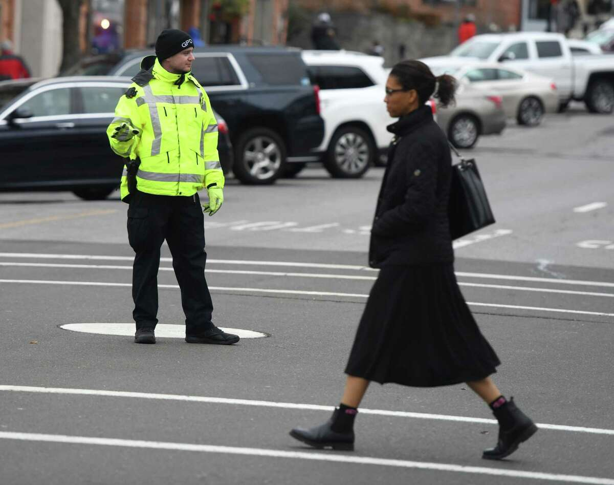 A Greenwich Police Officer directs traffic at the intersection of Greenwich Avenue and Elm Street in Greenwich in January 2020. A RTM resolution calling for officers to be assigned back to those positions was voted down by the body Monday night.
