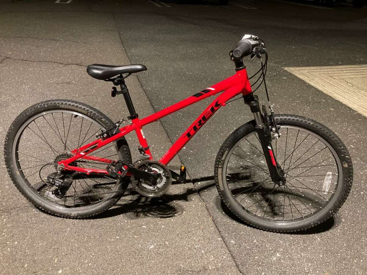 Police say the suspect left behind this bicycle on the lawn of a South Windsor, Conn., resident's home on Wednesday, Jan. 21, 2021.