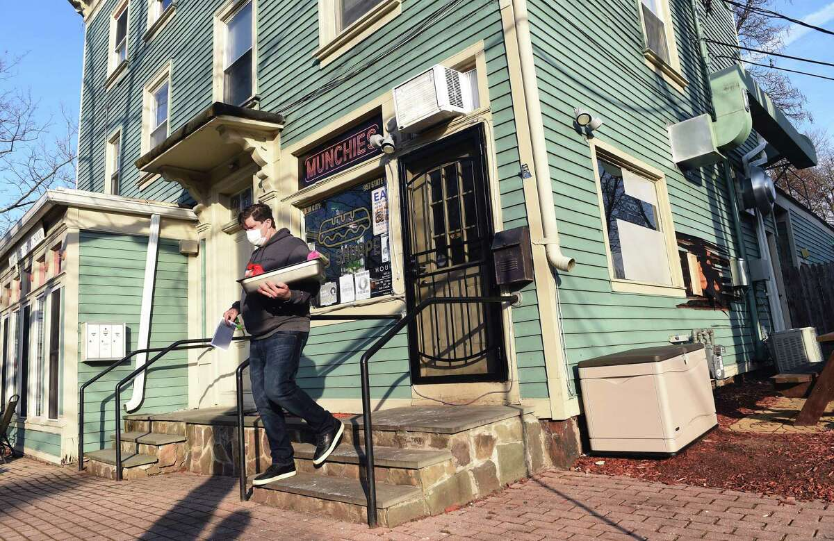 Drew Osbon, owner of Munchies, at 957 State Street in New Haven leaves at the close of the day at the newly opened business on January 21, 2021. Osbon, however, vowed his business will rise from the ashes.