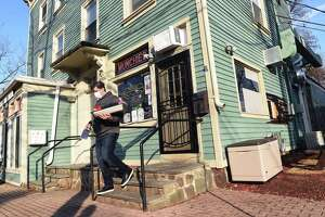 Drew Osbon, owner of Munchies, at 957 State St. in New Haven, leaves at the close of the day Jan. 21, 2021.