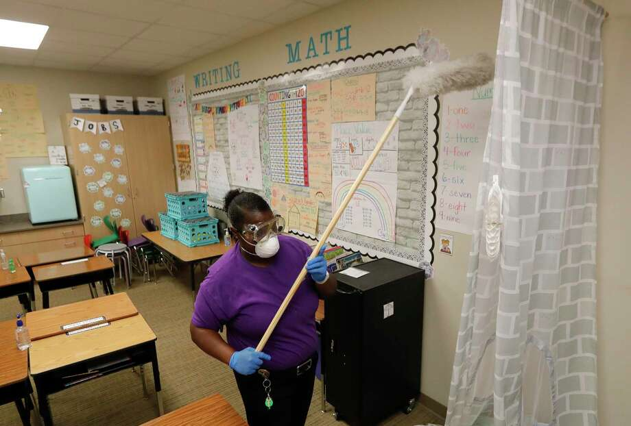 Custodian Jessica Frear disinfects a classroom at Lincoln Elementary School, Thursday, March 12, 2020, in Montgomery. Photo: Jason Fochtman, Houston Chronicle / Staff Photographer / Houston Chronicle  © 2020