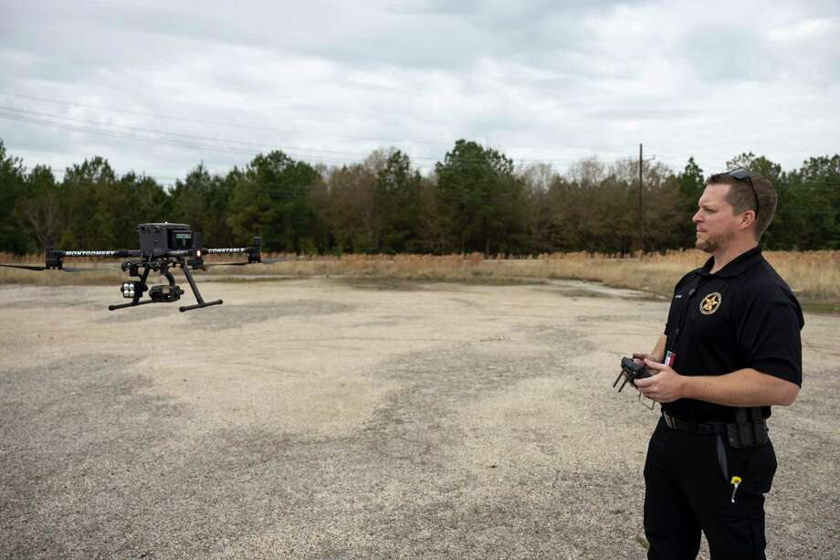 Lt. Slack controls a drone near the Montgomery County Precinct 4 Constable's Office, Tuesday, Jan. 19, 2021, in New Caney. Over 10 deputies with the office began the drone program in November and were fully licensed in December of 2020. Photo: Gustavo Huerta, Houston Chronicle / Staff Photographer / 2020 © Houston Chronicle