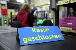 A closed check-out counter sign in a supermarket in Berlin on Jan. 19, 2021.