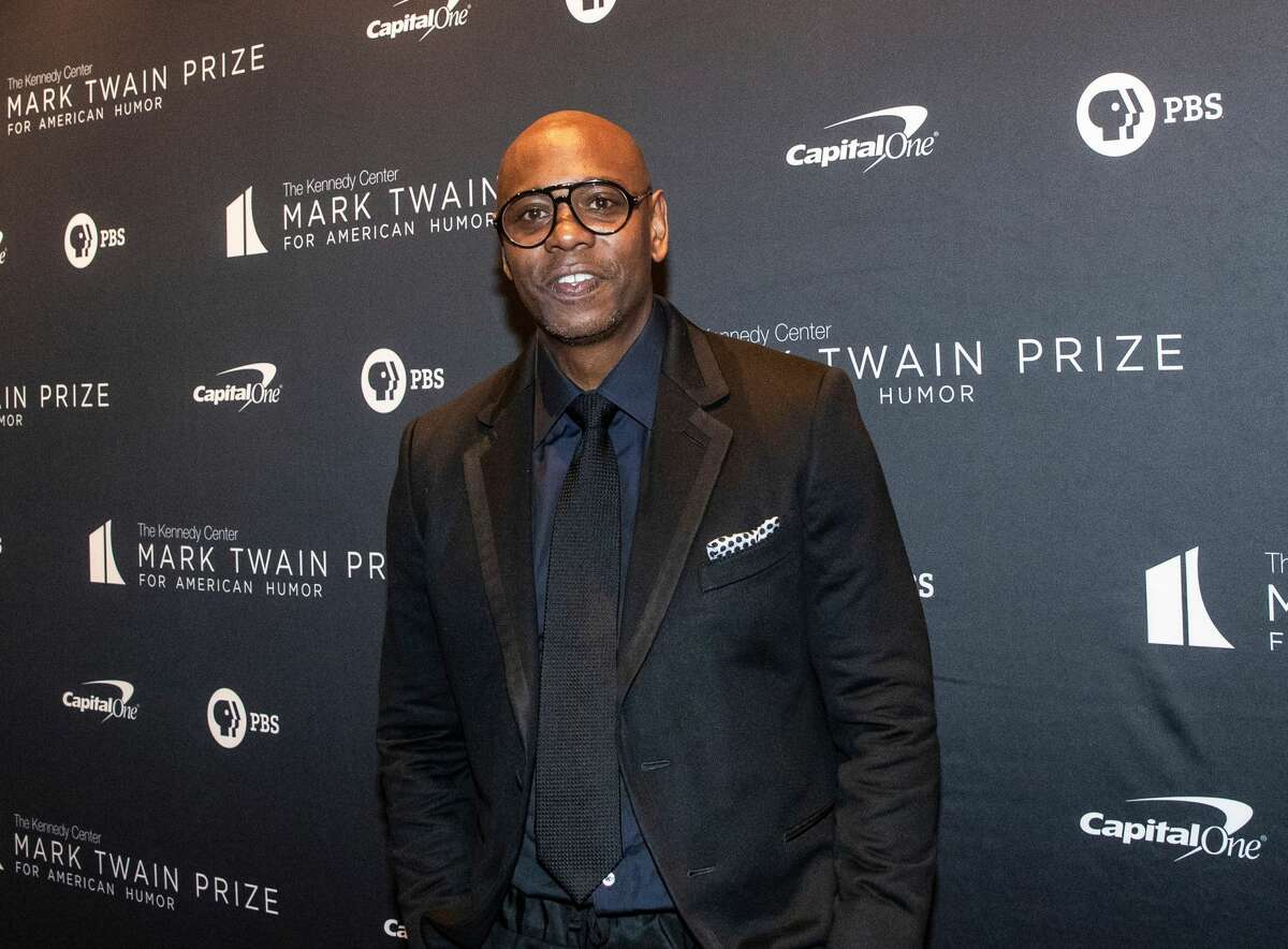Comedian Dave Chappelle arrives at the Kennedy Center for the Mark Twain Award for American Humor on October 27, 2019 in Washington, D.C. Chappelle canceled several Austin shows scheduled for this weekend after testing positive for COVID-19, news outlets reported.